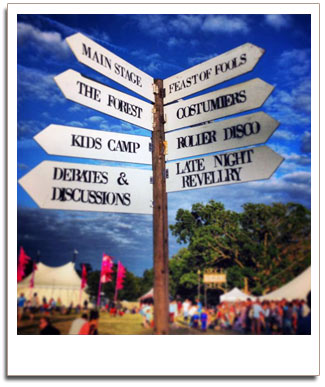 Alternative Festival weddings signpost set against a blue sky