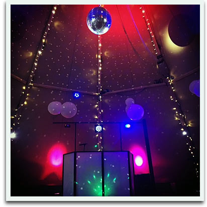 Inside festival wedding marquee, lighting and disco ball